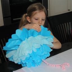 DIY Tissue Paper Puff Decorations. these are great for partys or for decorating the Kids room. And so easy to make!