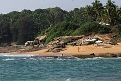 https://flic.kr/p/Fk6qWo | Chowara beach cove, Kerala, India | A few swimmers at a beautiful cove at Chowara beach.