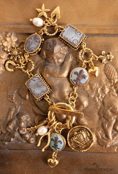 The Nunn Design 2014 Summer Release is packed full of fun charms.  This bracelet was created by texturing and sculpting epoxy clay and applying colorized resin.