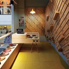 For this space-strapped shoe store in Santiago, Chile, the architects - MoVe architects- took the humble shoebox and made it into the store's central focus (killing the need for storage and visual interest with one stone), creating a shoebox-wall made from 6 plywood sheets and 140 wooden X's.