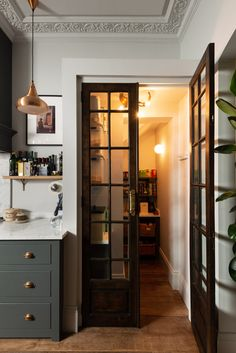 We are absolutely in love with these vintage pantry doors, this little under the stairs cupboard has been transformed into a seriously useful pantry and a really special feature of this kitchen. A great source of kitchen inspiration if you're hoping to design a walk-in pantry that feels a little different and special.