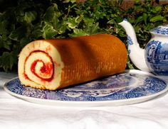 Swiss Roll is a rolled sponge cake with a filling, usually jam. You slice it sideways across the end; each slice reveals a spiral pattern. http://www.cooksinfo.com/swiss-roll