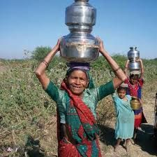 Woman carrying a bucket of water