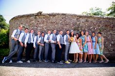 1-i love the short wedding dress. 2-i love his yellow sneakers && tie. 3-does anyone else notice the 8 foot man?!
