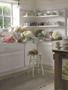 diamond back-splash, white marble counter top,bead board cupboards!window...sink...rustic wood island!