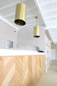 Restaurante Abadia. herringbone reception desk panels.