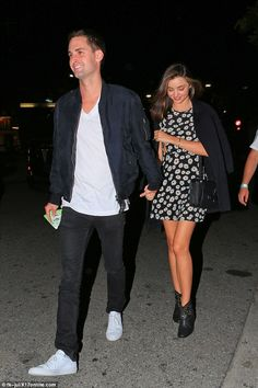 Miranda Kerr glows as she wears floral dress to hold hands with Snapchat billionaire Evan Spiegel  : The Swarovski spokesperson wore a black jacket over her daisy minidress with ...