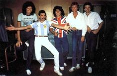Diego Maradona in a Union Jack t shirt with Brian May Freddie Mercury Roger Taylor John Deacon from Queen 1981.