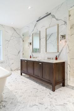 Artistic Tile I This luxe Brooklyn townhouse was tiled with 25 slabs of Calacatta Gold marble (including book-matched slabs) on bathroom walls and vanities, and matching Calacatta Gold mosaics on all bathroom floors.
