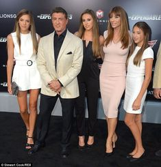 Family man! Sylvester Stallone, 68, also arrived to the premiere for his film The Expendables 3 with his lovely family (L to R) daughters Sistene Rose Stallone, Sophia Rose, wife Jennifer Flavin, and daughter Scarlet Rose