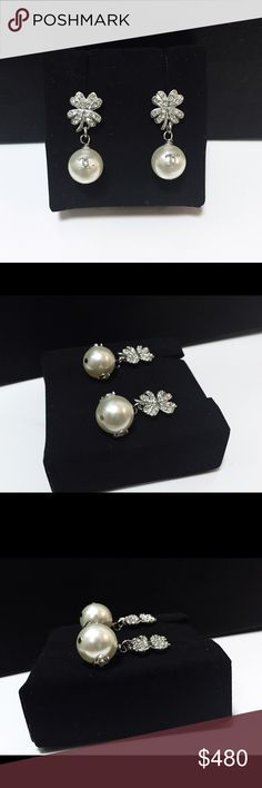 Auth Chanel Clover Crystal CC Pearl Drop Earrings Pristine condition! Clover flower- 10mm x 12mm  pearl - 10mm x 10mm  Entire height - 27mm  100% GUARANTEED AUTHENTIC! PHOTOS ARE TAKEN OF THE EXACT SAME ITEM YOU WILL RECEIVE! WHAT YOU SEE IS WHAT YOU GET*** PLEASE VISIT OUR WEBSITE AT WWW.AUTHENTICLUXURIESTW.COM or email me at authenticluxuries11@gmail.com for more detailed photos =). CHANEL Jewelry Earrings