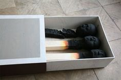 Matchstickmen: Burnt Matches Resembling Charred Human Heads by Wolfgang Stiller