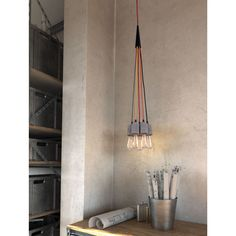 Bring antiquated charm to your home decor with this remarkable 5-light ceiling lamp. This concrete and metal lamp features a concrete grey finish for a complete design.