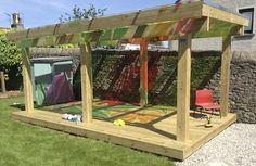 "Gorgeous shelter at Maisie's Children's Centre - from I'm a teacher, get me OUTSIDE here! ("",) Would also look great with vines growing up the posts - would be an amazing art space outdoors with the colours"