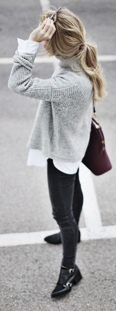Grey turtleneck, this winter's staple. Break up the monochrome with understated burgundy accessories.