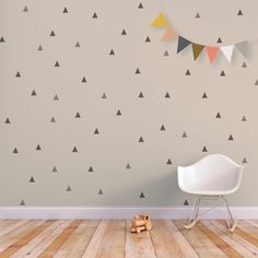 Here is your change to add not one or two, but fifty six geometric shapes to just one room. The Little Peaks wall decal set is removable and reusable.