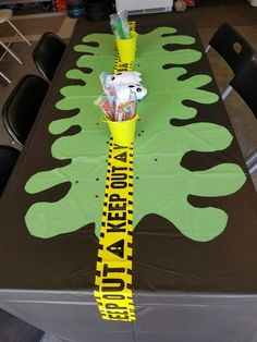 """Great idea for a Grossery Gang birthday party! Lay down a dark colored plastic tablecloth and cut out a """"slime"""" spill from a green plastic tablecloth to put on top. Add a strip of caution tape and voila! A slime scene fit for the grossest party! 10th Birthday Parties, 4th Birthday, Birthday Party Decorations, Birthday Ideas, Ghostbusters Theme, Ghostbusters Birthday Party, Mad Scientist Party, Science Party, Mad Science"""