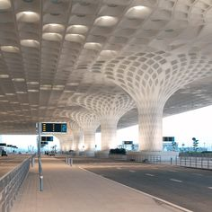 A coffered concrete canopy spans this new airport terminal in Mumbai, India, designed by American firm SOM.