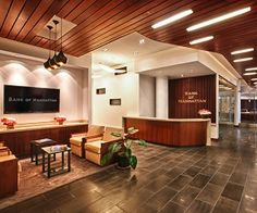 The bank's goals were to improve and expand their existing space, including linking the entrances, offices, work areas and conference rooms into a more cohesive whole.