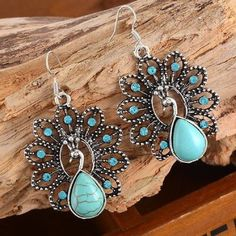 """TURQUOISE RHINESTONE PEACOCK EARRINGS!! Cute Drop Earrings that are faux Turquoise & Silver with rhinestones, as a Peacock!! 2"""" in size. Comes in bag. No trades. Jewelry Earrings"""