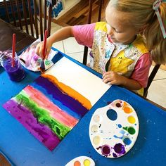 Loving her art project today! She's painting the background of what will be her weaving mat tomorrow! (Home Art Studio, 1st Grade)