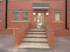 The steps up to this housing complex are relatively shallow, but clear nosings are absent and colour contrast is minimal. The tread of each step step takes up more than two standard paving slabs. There is no handrail.  At the top of the steps there is no landing to stand on.   Image courtesy of Sandra Manley, UWE. Paving Slabs, Colour Contrast, Shallow, Landing, Minimalism, Outdoor Decor, Top, Image, Design