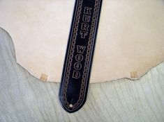 Name guitar strap on leather.