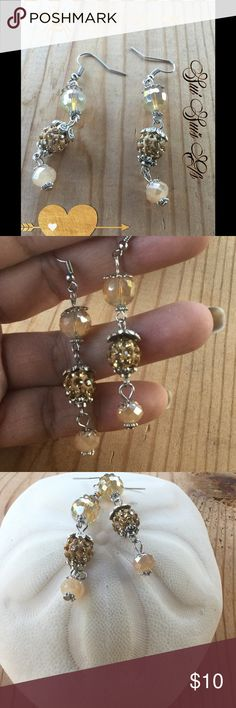 Dangle crystal earrings Gold and cream color dangle earrings. Jewelry Earrings