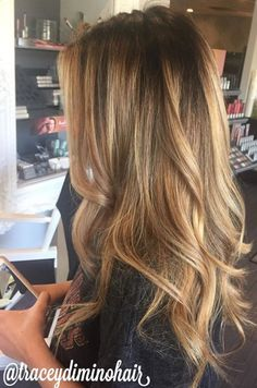 Blonde balayage highlights, long hair, painted highlights, beautiful hair, curls, dark root, balayage ombre More