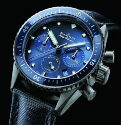 Blancpain has released a new limited edition (of 250 pieces) ref. 5200-0240-52A version of the Bathyscaphe Chronograph as the Blancplain Ocean Commitment Bathyscaphe Chronographe Flyback with a blue dial and bezel in a titanium case. Also available in steel with a grey dial or full brushed ceramic with a matching black dial, there's not a bad choice in the entire Bathyscaphe range... see our hands-on review of the Blancpain Fifty Fathoms Bathyscaphe, now updated to include this version...