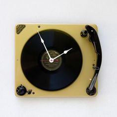 Clock made from a recycled  vintage yellow console turntable with a vinyl record. I think I need this clock!