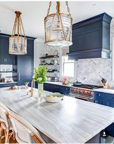 Beautiful kitchen with modern light fixtures, blue cabinets and grey backsplash . Beautiful kitchen with modern light fixtures, blue cabinets and grey backsplash and countertops Interior Design, Home Decor Kitchen, Interior, Kitchen Design, New Kitchen Cabinets, Blue Kitchens, Blue Kitchen Cabinets, Home Decor, Beautiful Kitchens