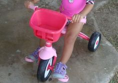 Pink Radio Flyer Tricycle with baby doll basket