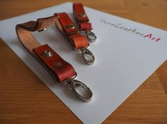This listing is for one off key fob. Hand made stained veg tanned leather key fob with hand stitching using waxed thread complete with chrome hasp for attaching to either keys or belt loop. As an option to the hand stiching I used a copper rivet, The key fob also has a press stud fastening for alternative fitting to belt loop or securely in a handbag , messenger bag, rucksack, travel bag.