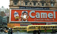 Smoking Camel Cigarette billboard in Times Square 1943.  Designed by Douglas Leigh, it was mounted on the Hotel Claridge.  Photographed by John F. Vachon.
