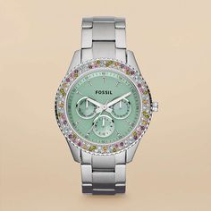 Fossil-Stella Stainless Steel Watch  Ninety-two multicolored stones encircle the mint green dial of this stainless steel Stella. We love the way the crystals add a feminine touch to this boyfriend-inspired watch.
