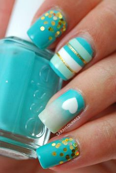 Gold stripes and cute little polka dots made by metallic foils on light blue nails.