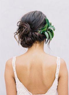 A classic wedding updo, loose side bun, romantic side swept updo