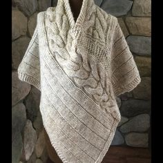 Knit Poncho, oatmeal yarn, large cable pattern. Soft comfy wool knit poncho. Pretty much one size say 6-14. Just in time for Spring. Leaves your arms free! Vintage Sweaters Shrugs & Ponchos