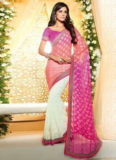 Rich look attire to give your a right choice for any party or function. Real beauty comes out from your dressing style with this hot pink and off white faux chiffon and brasso designer saree. This lov...