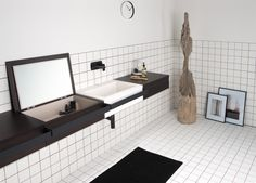 The furniture module, designed to clear the bathroom shelves from too many objects, when opened, has a compartment used as a container and equipped, on request, with a triple electrical socket: standard, German and usb, useful for hair, mobile phones charges, electric toothbrushes.