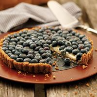 Blueberry Tart With Walnut Crust  filled with maple-sweetened cream and fresh blueberries