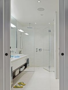 modern bathroom with white tile http://www.dwell.com/house-tours/slideshow/renovated-loft-soho#9