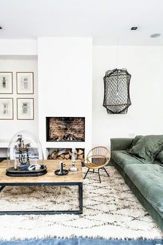 Living room with a Beni Ourain Rug and a green sofa