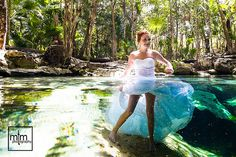 This Trash The Dress Bride has the coolest way of keeping Cool, swirling her dress in the crystal clear cenote waters on her TTD photo shoot!!!  MTM Photography in Mayan Riviera Wedding Photographer. Wedding Photographer photos in Cancun, Playa del Carmen, Puerto Morelos, Puerto Aventuras and Tulum. www.MomentsThatMatterPhotography.com Cenote Trash the Dress 10