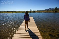 SEE I'M SMILING *** A woman walking on a dock.