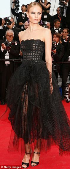 Leggy: Natasha Poly, left, showeed skin in a see-through black gown, as  Isabeli Fontana, right, dislayed her lean limbs in a sleeveless yel...