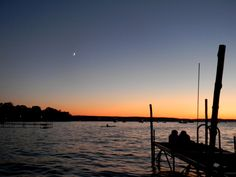 Chautauqua Lake, NY. I'd totally lay on the dock like those two and watch the sun set.