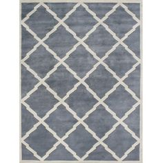 @Overstock - Cover your hardwood floors with this fashionable hand-tufted wool area rug. With a blue-gray background and cream-colored geometric accents, this contemporary rug offers your space an eye-catching boost that suits many modern decor schemes with ease.http://www.overstock.com/Home-Garden/Alliyah-Handmade-Bluish-Grey-New-Zeeland-Blend-Wool-Rug-9-x-12/6071117/product.html?CID=219283