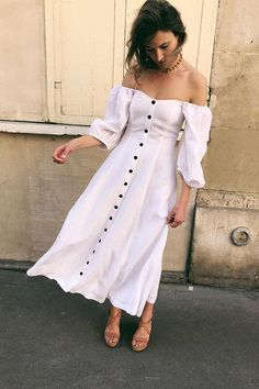 What to wear to a city wedding: model wears mara hoffman white dress with brown sandals